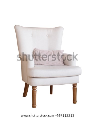 soft arm-chair with a pillow isolated on white. Armchair with fabric upholstery