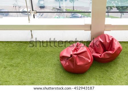 Soft Beanbag Seats On Green Grass In Modern Office Building