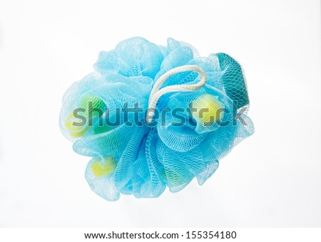 Soft blue bath puff or sponge isolated on white background