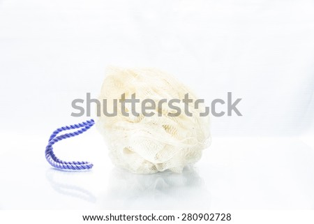 Soft blue bath puff or sponge isolated on white background - stock photo
