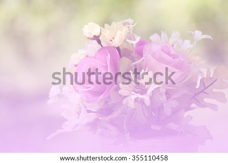 Soft blurred of Roses Bouquet  in a wooden basket.  Background vintage style - stock photo