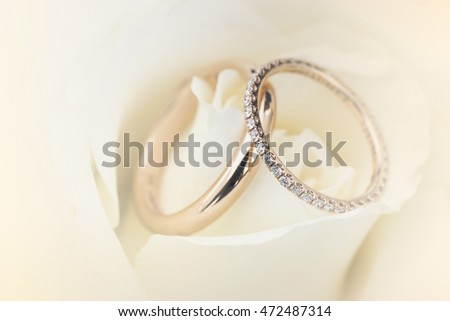 Soft blurred of wedding ring on a rose pastel color style background.