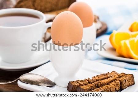Soft boiled egg for breakfast - stock photo