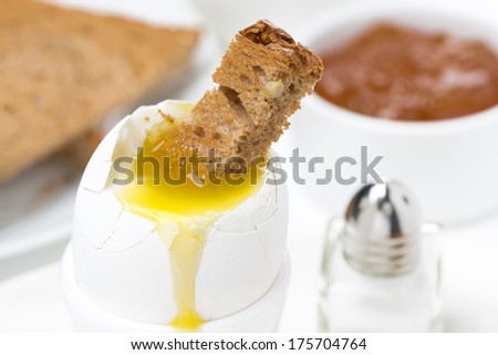 soft boiled egg with toast for breakfast, close-up, horizontal - stock photo