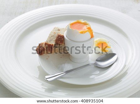 Soft boiled egg with toasted bread soldiers - stock photo