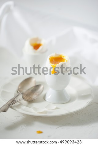 Soft boiled eggs on the white table