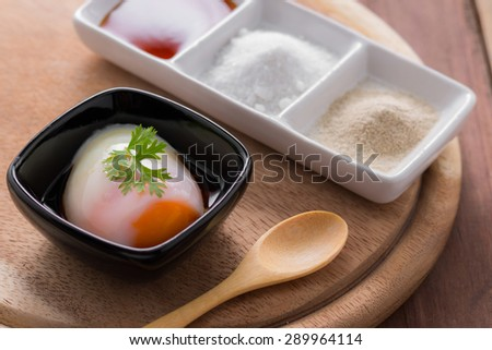 Soft boiled eggs on wooden table. - stock photo