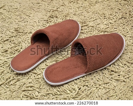 Soft brown color slippers on bathroom carpet        - stock photo