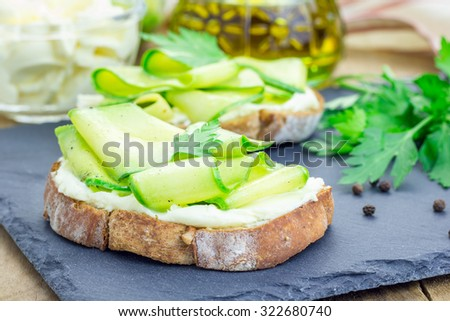 Soft cheese and zucchini bruschetta - stock photo