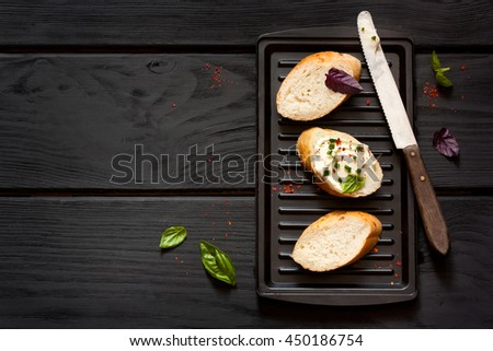 Soft cheese sandwiches with herbs on grill.