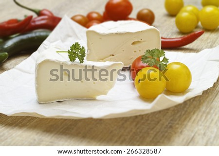 Soft cheese with tomatoes