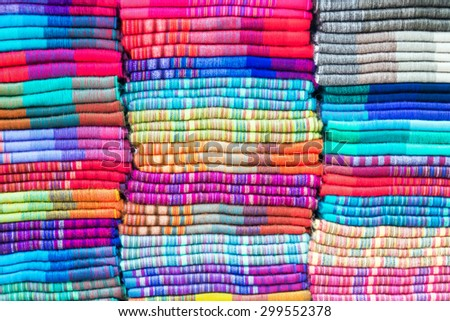 Soft colorful blankets made out of alpaca wool in the famed market of Otavalo, Ecuador - stock photo