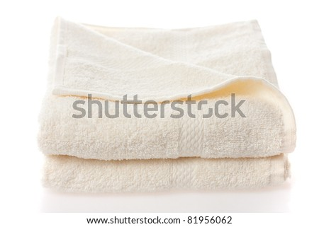 Soft cotton towels isolated on a white - stock photo