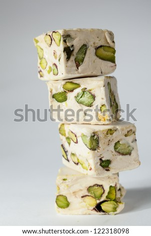 Soft cubes with pistachios - stock photo