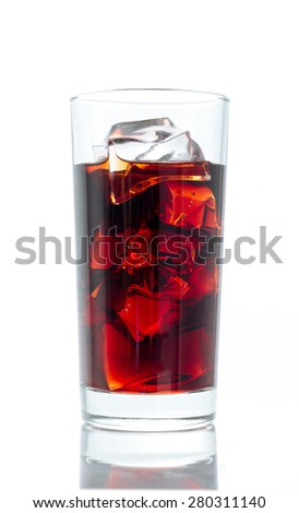 Soft drink. Cocktail glass with red liquid & ice cubes. - stock photo