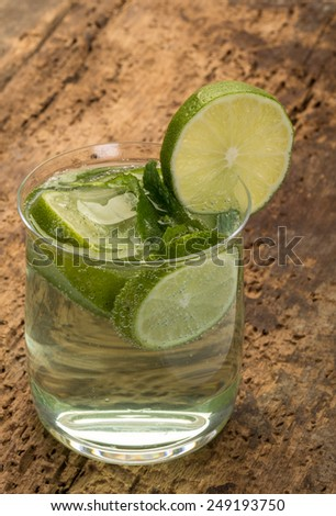 soft drink decorated with lime and mint leaves - stock photo