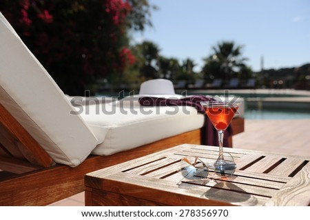 soft drink in a beach chair by the pool of a luxury hotel - stock photo