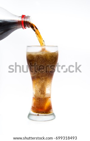 soft drink with caffeine is poured into a glass with ice on the
