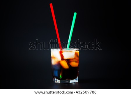 soft drinks. Cola glass with ice cubes on a white background