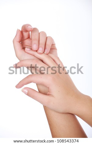 Soft feminine female hands with french manicured nails - stock photo