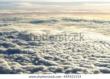 soft focus above clouds sky on airplane with the beautiful sunset. Flying above the clouds. View from airplane. - stock photo