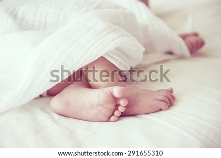 Soft focus and blurry of Baby Feet, vintage style color effect