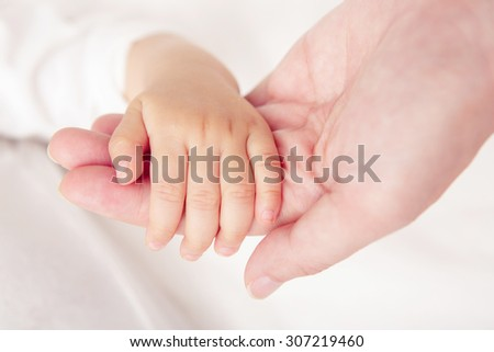 Soft focus and blurry of Baby Hands, vintage style color effect
