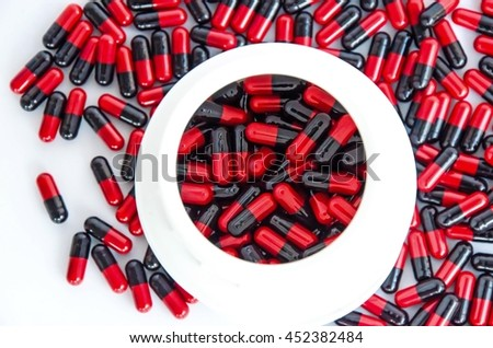 soft focus antibiotics /penicillin /pill medicine/capsules red&black medicines on white background - stock photo