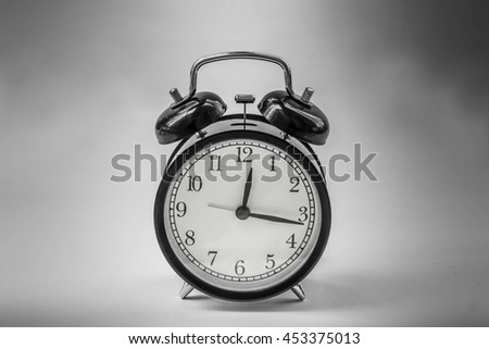 Soft focus Antique black metal alarm clock in the dark
