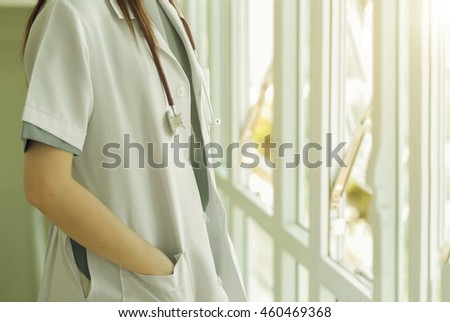 Soft focus Asian medical female doctor or nurse and stethoscope in hospital with color tone , blurred background. - stock photo