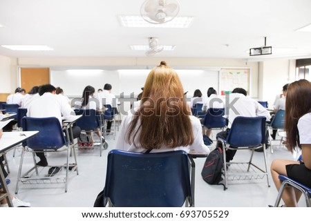 Soft Focus Back View Abstract Background Of Examination Room With Undergraduate Students Inside University