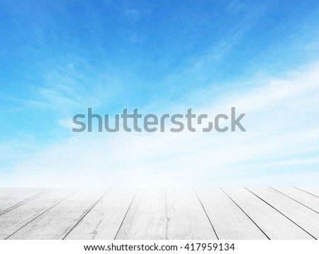 Soft focus clouds sky background white old wood floor. Blur blue sky white sunlight day time background. Abstract blurred on vacation summer ocean beach. Wooden stage for watching nature. - stock photo