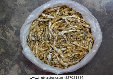 soft focus dried anchovies in plastic bag