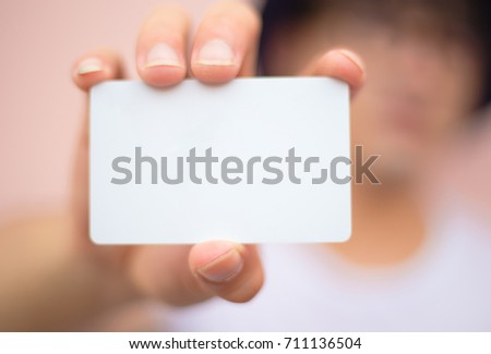 soft focus.hand business man holding business card with empty space for text. on blurred background
