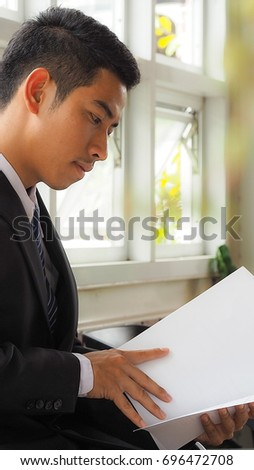 Soft focus image, Business man hand and resume paper for a job interview concept