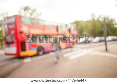 Soft focus image of young women crossing the crossroad of modern city. Ecological means of traveling.