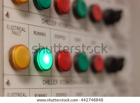 Soft focus industrial background the electrical running engine lighting on control panel board at electrical safety room . - stock photo