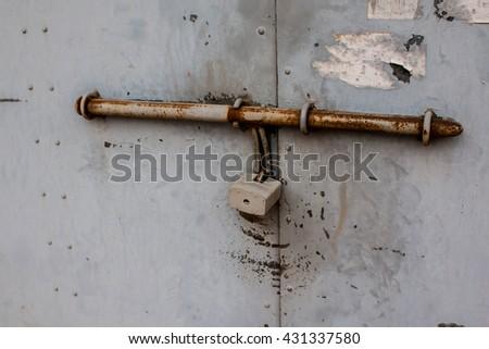 Soft focus Metal door with lock - stock photo