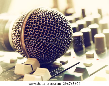soft focus microphone and sound control with vintage film color effect - stock photo