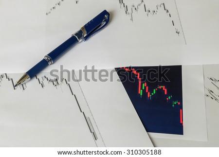 Soft focus of graph analysis work concept under window light in work room - stock photo