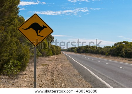 Soft focus of Kangaroo crossing road sign next to the road on Princess Highway at Coorong National Park in South Australia - stock photo