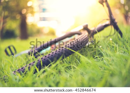 Soft focus of mountain bike on green grass background - stock photo