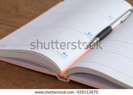 Soft focus of pen with organizer book, personal organizer or planner on notebooks - stock photo