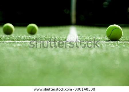 soft focus of tennis ball on tennis grass court - stock photo