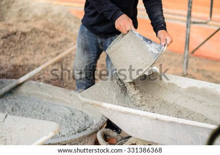 soft focus or Selective focus  construction workers pouring cement  - stock photo