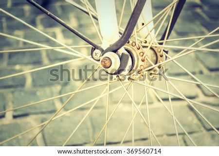 Soft focus point on bicycle wheel - Vintage Filter