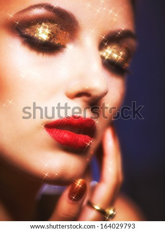 Soft focus portrait of beautiful young woman with shining face makeup