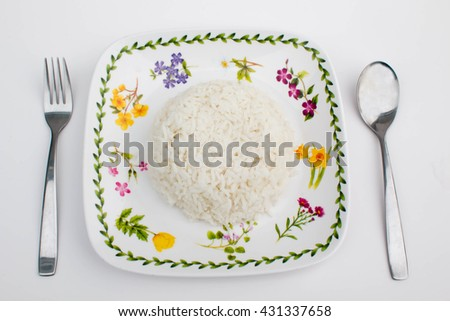 Soft focus Rice in white bowl and chopsticks on white background/ top view. - stock photo
