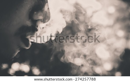soft focus ,selection focus area , blurred background ,man smoking : color filter  unhealthy concept - stock photo