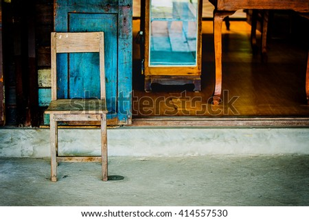 soft focus Vintage chair front of an antique shop.vintage filter - stock photo